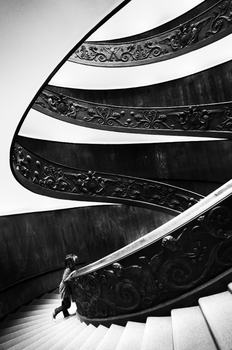 architecture photography of a spiral staircase in black and white
