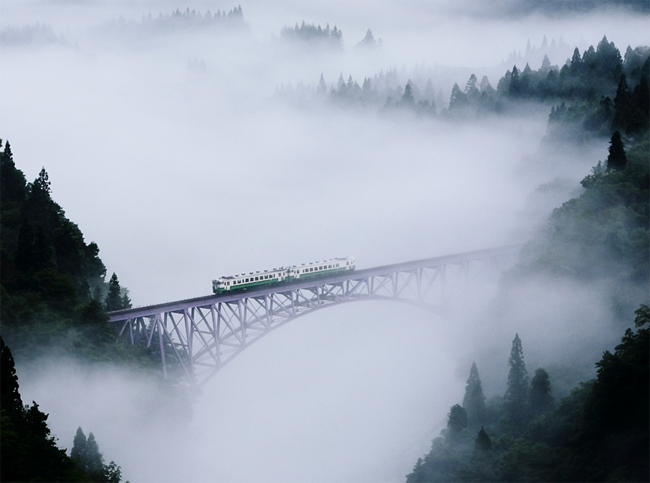 train on a bridge within a foggy valley in Fukushima, Japan - photography