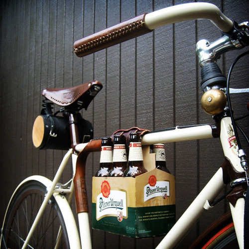 Honored by Architizer as one of the Ten Best Bike-related Design Innovations of 2011, this leather frame cinch secures just about anything somewhat narrow to your top tube - why not a six pack?  Featured in Beer West Magazine, Time Out Chicago, Gizmodo, and more.  Originally designed by and for a Hardcourt Bike Polo aficionado, we since learned that this useful item can hold all kinds of things to your bike.  The strap is adjustable to hold variably sized items. One of our customers uses two to hold her kayak paddle!  The six-pack rests nicely between your knees (not knocking into them!). Check out testimonials from customers on our feedback page: http://www.etsy.com/people/WalnutStudiolo/feedback?ref=pr_feedback  See an installation video on our YouTube channel: http://youtu.be/3a1RWqbk00c  This product was burned by bikesnobnyc! http://bikesnobnyc.blogspot.com/2010/07/throwing-down-your-arms-time-and-place.html  As bike polo mallet holders, these bundle together mallet cues and secure the mallets to your bike's top tube. Bike polo tested and approved! Besides being devilishly stylish, the mallet cue holder will keep players honest on which cues they should use and organizes mallets so players can easily see which game is next.