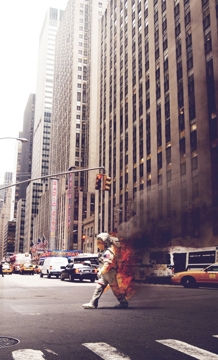 Photography art showing a burning astronaut walking through the streets of New York jack crossing, street building city usa america nasa fire burning photo art portrait photography flickr tumblr