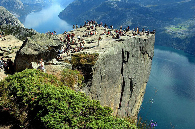 Photography of Preachers Rock, Preikestolen, Norway picnic, rock, view, cliff, river, valley, tourists, group, stunning amazing landscapephotograph landscape photography norway