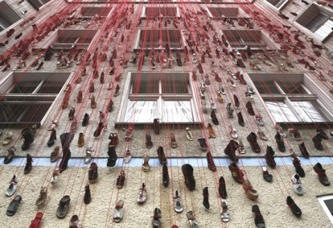 Shoes on strings, House of Imagination by Heimat, Berlin art installation hanging shoes of facade building fassade schuhe berlin, germany art installation