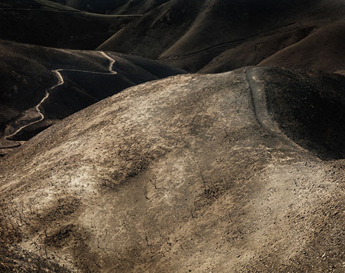 landscape photograph desert road wasteland mountains hills sparse ground earth photography tumblr flickr