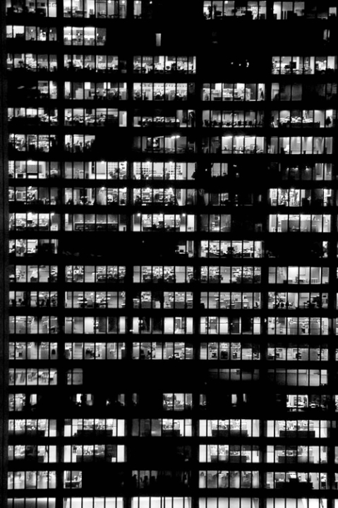 Black and white photograph of an office building at night, working late, architecture photography art image facade dark black light lighting night contrast image tumblr