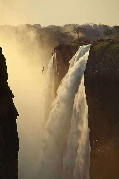 Photography of a person jumping down a large waterfall nature photography dangerous landscaspe photo tumblr