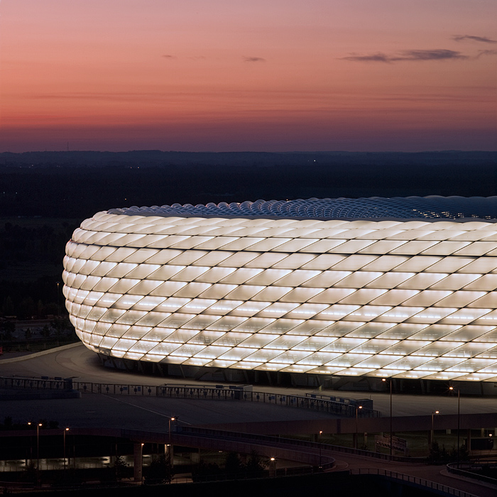 Photograph of the Allianz Arena Munich night evening light bayern muenchen munich germany architecture ptfe pillow facade fabric construction air cushion structure