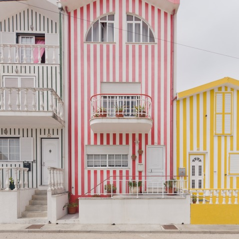 Colorful houses of Costa Nova, Aveiro, Portugal architecture photography colours summer colourful facades texture pattern doors windows photo image