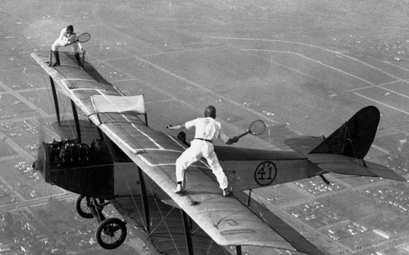 airplane tennis  flying circus plane sport playing photograph photography black and white vintage history
