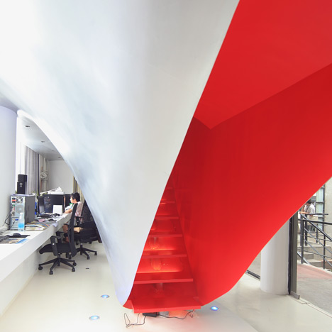 Red Town Office by Taranta Creations architecture architects The Shanghai office of Chinese architecture studio Taranta Creations features a staircase within a labia-like orifice and a floor that doubles as a desk. furniture design minimal office working innovative colour