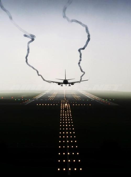 airplane plane aerodynamic flying photography airport  smoke wings landing strip air taking off landing strip photograph image