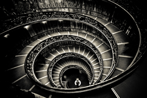 Vatican Museum in The Vatican City library stairs spiral black and white photography religion art dark constrast organic staircase architecture photography image