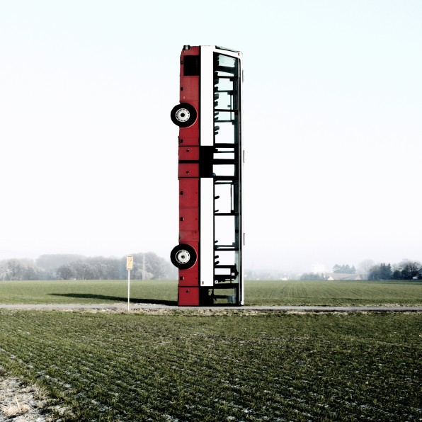 complete stop vertical bus art work photography photograph car up side down bus standing in a field installation sculpture