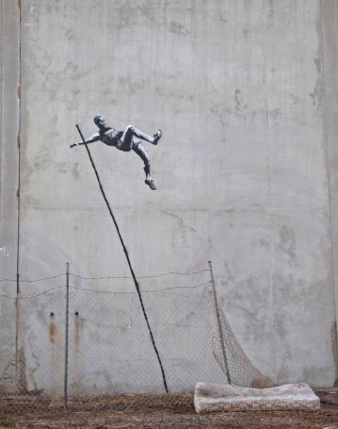 olympic games graffiti spray paint art wall mattress high jump artist banksy architecture photography photograh spraying art