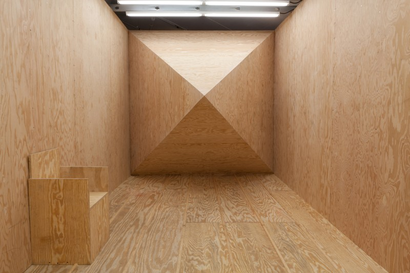 Julian Hoeber camouflage, wooden chamber interior 3D formed hanging chair minimalistic design interior design photography volume geometries