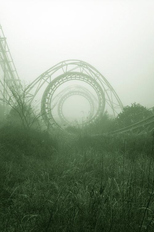 green rollercoaster grass amusement park fun ride photography abstract mist fog photograph mystery
