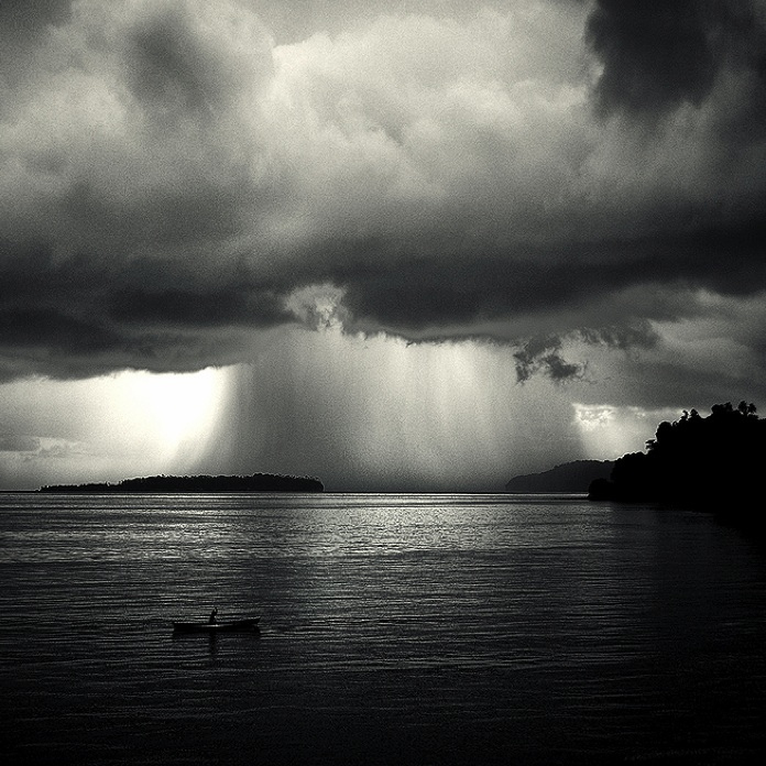 why does it rain on me song music photo image beautiufl black and white vintage landscape photography of sea ocea clouds and rain water weather amazing photography on the best photography blog wordpress