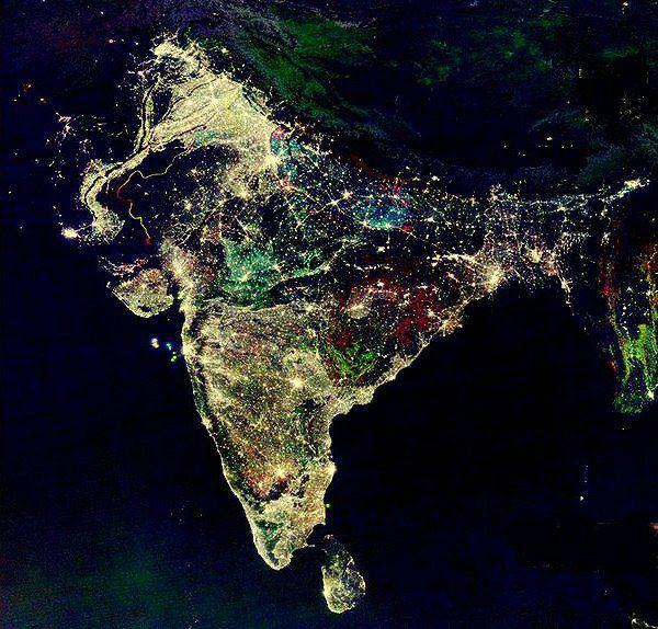 diwali festival of lights india satellite imagery night sky India at night, satellite view. This image is a composite showing the change in illumination over India from 1992-2003. Nighttime lights on the map that are white are lights that were present throughout the entire period. Areas that are marked by red have only appeared in 2003. Areas coloured green and blue were only present in 1998 and 1992 respectively but are no longer visible. This image was created by the Defense Meteorological Satellite Program (DMSP), National Oceanic & Atmospheric Administration,