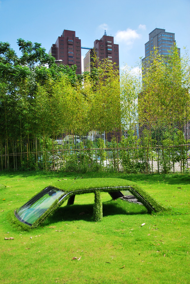 "By the looks of the CMP Block art installation, nature is finally fighting back against all the pollution humans and their machinery have wrought upon the world. In this case, the grass in a particular spot in Taiwan has decided to rise up against the fuel-burning cars that somehow drove into its dewy, green grip. Half-consumed, the cars are mossy versions of their former selves, yet they are somehow made the better for it.  Comprised of two cars, the CMP Block art installation ""seeks to merge art, aesthetics and nature,"" according to This Is Colossal. Visually stunning, an imaginative story can be built around this art piece even in spite of the knowledge that is was created by humans. It may even inspire people to give their cars a rest."