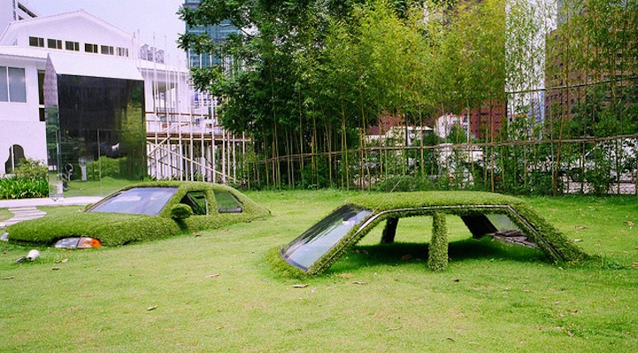 green car drowning grass sinking ground art installation  Cars Swallowed by Grass at CMP Block in Taiwan