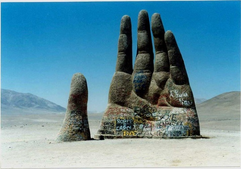 weekend hand emerging sculpture stone dessert landscape graffiti art human palm emerge from the earth photography photo