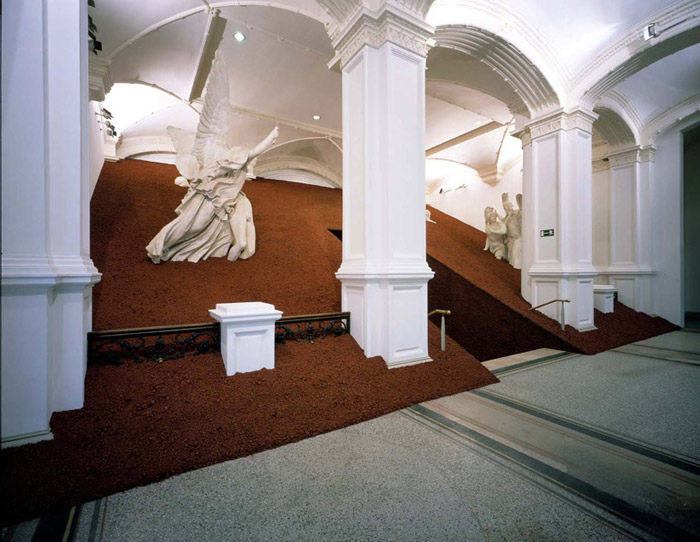 'Domestication of Pyramids' by Magdalena Jetelová are pyramid-sculptures, covered by volcanic ashes, and have been shown at the Museum of Applied Arts / Vienna, Martin-Gropius-Bau / Berlin, National Museum of Contemporary Art / Warsaw, Irish Museum of Modern Art / Dublin, Forum Kunst Rottweil and other art spaces.