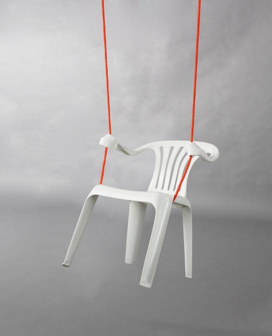 'monobloc' by bert loeschner  art hanging swing white plastic chair artist gallery sculpture blog best design Bert Loeschner is a series of plastic chairs that have been modified using heat.