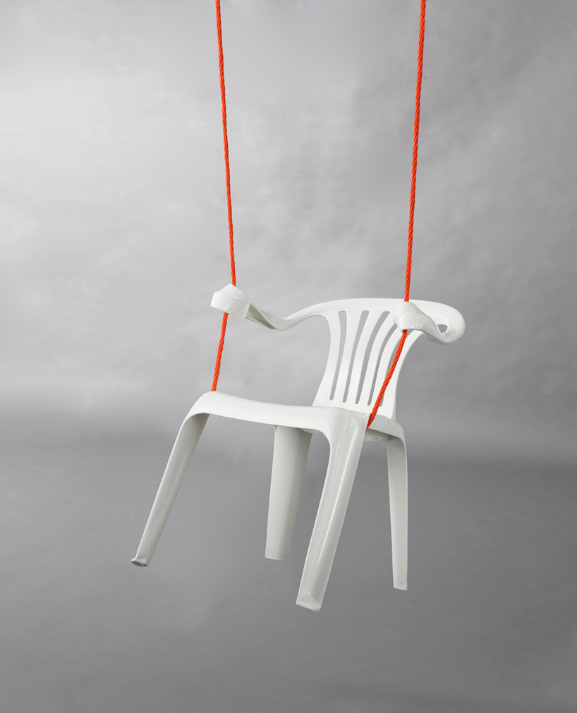 'monobloc' by bert loeschner  art hanging swing white plastic chair artist gallery sculpture blog best design Bert Loeschner is a series of plastic chairs that have been modified using heat.