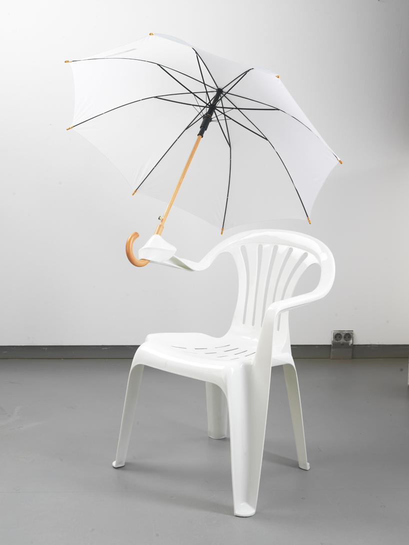 """monobloc waterproof umbrella white plastic chair sculpture """"Monobloc"""" by Bert Loeschner is a series of plastic chairs that have been modified using heat. With no concern for functionality and comfort, Loeschner has transformed commonplace plastic products into a strikingly diverse collection of sculptural seating. The project is about the 'infamous garden chair' and its role in design culture.<br />'monobloc' by bert loeschner<br />the rocking chair, 2011,<br />transformed polypropylene chair/ polypropylene string<br />transformed using heat, 'monobloc', the titled series of reconstructed seating objects"""