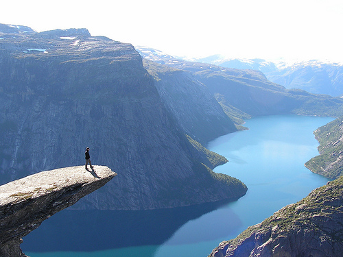 Trolltunga norway rock view wallpaper landscape photography stunning nature cliff mountains hanging Trolltunga is a piece of rock that stands horizontally out of the mountain above Skjeggedal in Odda, Norway