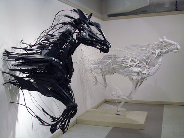 horses wild animals competition running finish line airy sculpture installation windy vivid black and white good and evil symbolic art photography photo