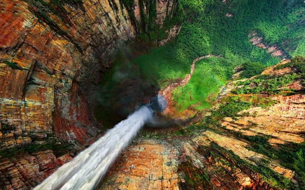 Angel Falls, and nearby Dragon and Cortina Falls in Venezuela Dragon Falls are part of the Angel Falls located in Venezuela. This Venezuela  watterfals are biggest in the world with height of little above 3,200 ft. Waterfalls drops from the edge of Auyantepui mountain in the Canaima National Park. Whole region is under UNESCO World Heritage.