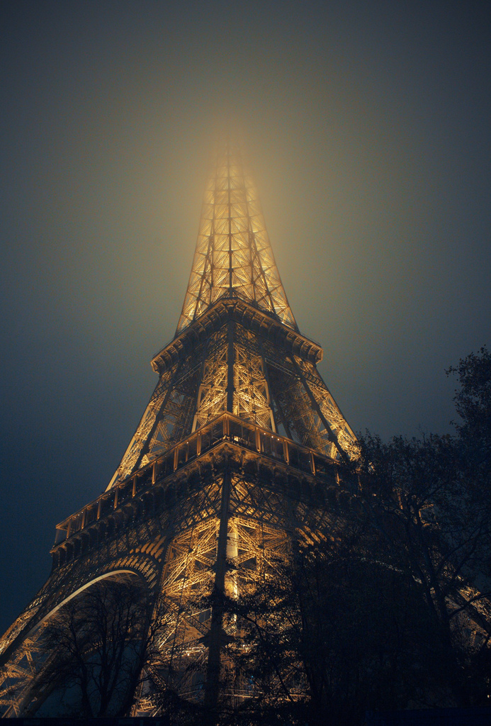 eiffel tower at night Paris France romantic light night in paris love romance beautiful places amazing to visit travel holiday weekeend architecture steel wonders of the world fog mist weather clouds