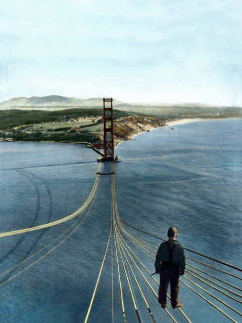 golden gate bridge construction cable suspension bridge usa san francisco balance construction worker balancing standing on steel cable view