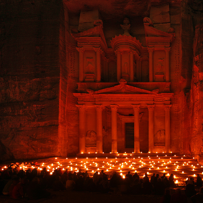 City of Petra Jordan at night photograph candles lights night beautiful red light color ancient city carved out of rock archaelogical wonder of the world amazing places to visit travel in the world bucket list