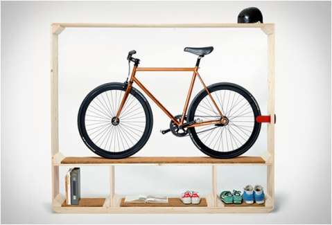 Shoes Books and a Bike cool way to store your bike bikestorage storage designer furniture modern swiss minimalist wood timber shelf biking inside bicycle art interior architecture