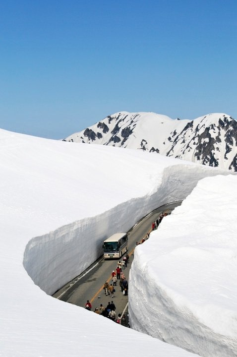 heavy snow bus road winter alps mountain holiday christmas weather cold  Tateyama Kurobe Alpine Route, Toyama, Japan.