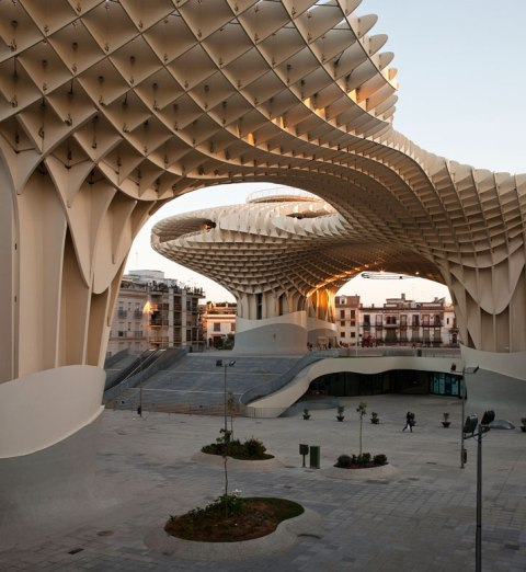 The Metropol Parasol - The world's largest wooden structure What is there not to like about Metropol Parasol?  The waffle-like crown structure in Seville, Spain has been finally completed in April 2011 after a competition held by the city of Seville in 2004.  Located at Plaza de la Encarnacion, the stunning sequence of undulating parasols comprises the world's largest wooden structure. The Metropol Parasol project was part of the redevelopment of the Plaza de la Encarnacíon, designed by J. MAYER H. Architects, this project becomes the new icon for Seville, a place of identification and to articulate Seville's role as one of the world´s most fascinating cultural destinations.