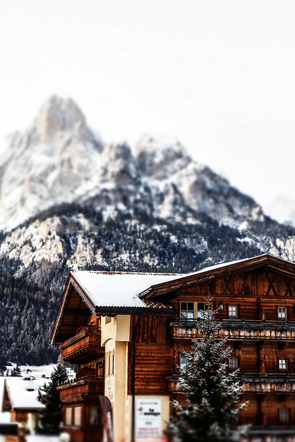 winter village holiday skiing alps mountains switzerland germany austria village log timber cabin traditional house rent apartment stay travel mountain view peak landscape photography traditional vernacular architecture