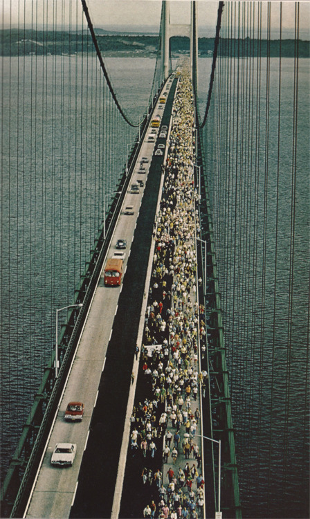 cable suspension bridge vintage 1970s old photograph 50s 60s people walking over it demonstration closed bridge architeture structure