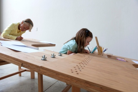 "One of the main intentions behind the design of Growth Table is to ""create an instant and inter-generational community united by the simple act of drawing."" Since kids spend such a great deal of time at a desk, to either do homework or pursue creative endeavors, this unique furniture presents an opportunity for a child to be engaged and nurtured in a group setting, as opposed to being isolated at a miniature table or desk of their own. And wouldn't Growth Table be the ultimate instant setting for home schooling multiple siblings?"