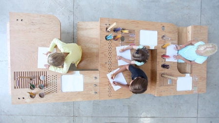 "There's an abundance of tables designed to accommodate family dinners, and a wide range of small art desks for kids, but Growth Table by designers Tim Durfee and Iris Anna Regn is the first family-sized drawing table we've seen — and it's truly inspiring. Durfee and Regn offer, ""Children impulsively and un-selfconsciously indulge in spontaneous mark-making when presented with a place to sit, a rightly-positioned surface, and colorful instruments with which to draw. The Growth Table creates these conditions — but at a range of scales — to also attract older children and adults who share the memory of countless hours of childhood art-making."""