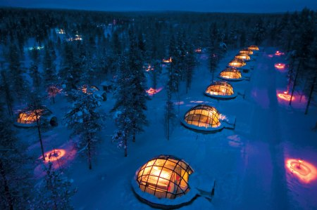 Kakslauttanen Igloo Village in Finland aurora crazy cool hotel innovative unique travel holiday winter season ice snow glass dome aurora watch phenomenon forest finland visit scandinavia romantic weekend