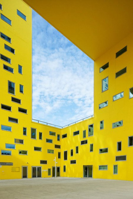 dzn_La-Cite-des-Affaires-by-Manuelle-Gautrand yellow courtyard architecture modern windows facade glass composition angles public building france architects studio designers