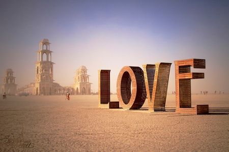 l( LOVE sculpture, Burning Man Festival 2011, Nevada, US. If you look close, you can see that the little holes in the metal lettering are carved out in the shape of little birds. / photographed by Sarah Bartell)
