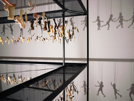 Structure of Shadow by Bohyun Yoon artist puppets disassembled part limbs structure artist installation light hanging puppets figures art exhibition sculpture