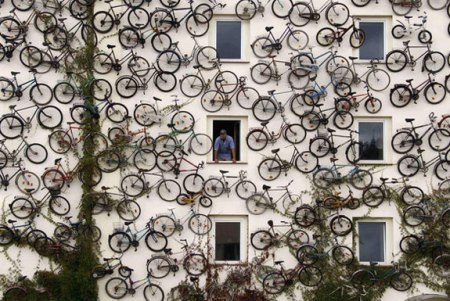 bicycle wall bikes hanging on wall facade art installation bike shop germany coolest store