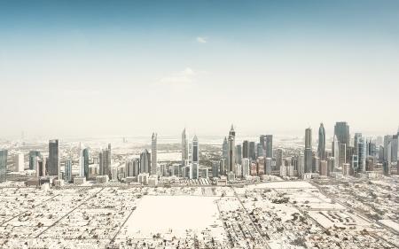 Dubai panorama skyline desert aerial photography landscape sand dust sky towers high rise skyscrapers insanity tallest building in the world burj al arab bury dubai hotel travel holiday visit