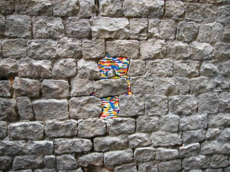 dispatchwork lego bricks art damaged walls old buidings gaps repair fixing patching up global movement community fun photography installation cities urban space architecture