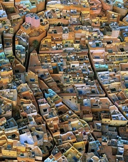 Beni Isguen. Algeria religous city travel adventure northen central sahara desert islam law hidden wonders of the world places to go visit world wonder national geographic dense city street traditional buildings sun protection