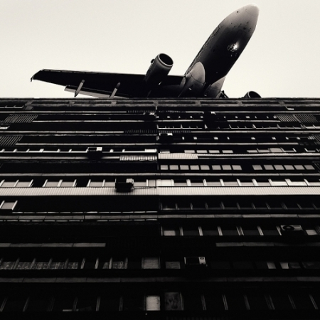 airplane building photography apartment flats contrast black and white low flight start landing noise proximity art monochrome